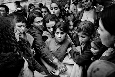 Friends and family gather for the funeral of a five year old boy in the Soacha slum area of Bogota. He and his eight year old sister were killed by the paramilitary. The eight year old girl was strang...