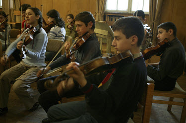 Young violinists practice at the Sayat Nova music school, one of 23 music schools in Yerevan. The school used to be free, but now charges a fee of 12 USD for piano tuition and six USD for other instru...