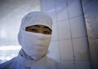 A worker stands guard at the closed Tianyang Food Processing Ltd. dumpling factory. Traces of methamidophos, an insecticide banned in many countries, were found in the dumplings, on the packaging and...
