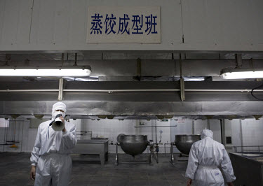 An official from the closed Tianyang Food Processing Ltd. dumpling factory speaks on a megaphone. Traces of methamidophos, an insecticide banned in many countries, were found in the dumplings, on the...