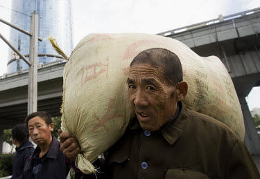 A migrant worker from Northern China arrives in Beijing looking for construction work. China's current migrant labour population working in cities is over 90 million, of which 45 percent are below 25...
