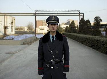 A guard at the closed Tianyang Food Processing Ltd. dumpling factory. Traces of methamidophos, an insecticide banned in many countries, were found in the dumplings, on the packaging and in the vomit o...