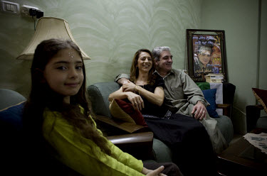 Mahir Fares, ex-militia chief of Nablus, with his wife Nil and daughter Rita.