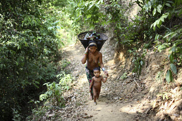 Mro (Mru) woman and child carrying water from a stream close to her village of Thanchi in the Chittagong Hill Tracts.