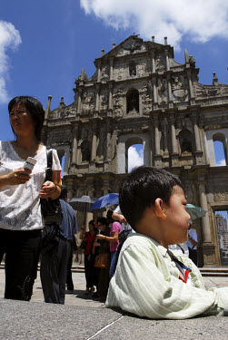 Mainland Chinese tourists in front of the facade of the ruins of St. Paul's church, Macau's most popular and identifiable attraction.
