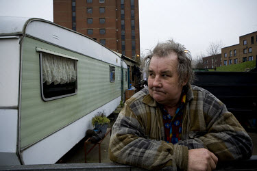 A man living in the Clays Lane mobile community in Stratford, East London. The area is one of a few in East London that have been marked for major redevelopment in the run-up to the London 2012 Olympi...