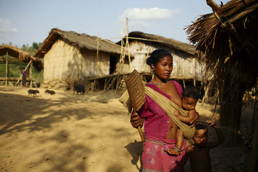A Mro (Mru) woman outside her home in the Chittagong Hill Tracts.