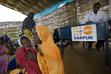 Women and children wait in the reception room of a small maternal health clinic run by medical NGO, Relief International, and co-funded by UNFPA (United Nations Population Fund). The clinic is on the...