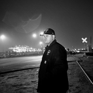 Longshoreman Virgil Maldenado in front the cranes of Global Docks, Bayonne, New Jersey. The docks of New York and New Jersey have for generations been synonymous with organised crime, with the Genoves...