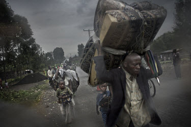 The road towards Goma crowded with IDPs (Internally Displaced Persons) fleeing violence in the towns and villages of Sake, Kirotske, Ngumba, Kilugu, Karuba and Mushaki. Tens of thousands are on the ro...