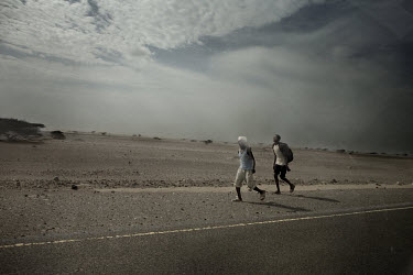 Somali refugees on the road. Hundreds choose to walk the long distance from the Kharaz refugee camp, or from the beach when they arrive in Yemen, to the city of Aden. The walk will last for several da...