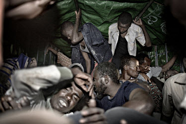 38 Somali refugees, having just arrived on the beach close to the town of Hosaisha on the coast of Yemen, are crammed into a UNHCR truck. They arrived, scared and exhausted, at 9pm after a dangerous c...