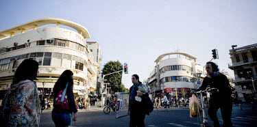 Allenby Street in central Tel Aviv. The building on the left is the Gottgold building, built in 1935 by architect Yehuda Magidovitch, and on the right is the Poliashuk building, built in 1934 by archi...
