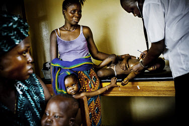 In a clinic in Gerihun, in Sierra Leone's Pujehun district, three year old Jewad Malukie, who has malaria, is examined by a physician from Meidcins Sans Frontieres (MSF). Fortunately, he has been diag...