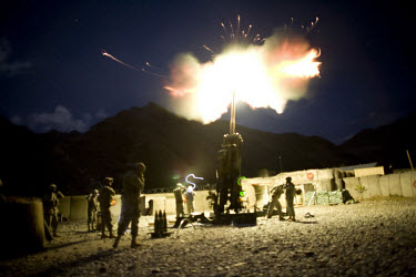 US Army soldiers from Charlie Battery, 3rd Battalion, 321st Field Artillery Regiment fire their 155mm canon at Firebase Sloan, Forward Operating Base (FOB) Blessing in the Pech Valley. They fired illu...