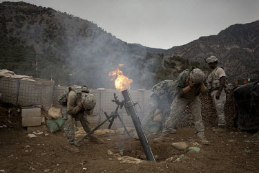 US Army soldiers from Viper Company 126, 2nd Platoon, fire 120mm mortars in defense of an attack on Restrepo Firebase in the restive Korengal Valley. During the attack Sgt Lacie was shot in the head a...