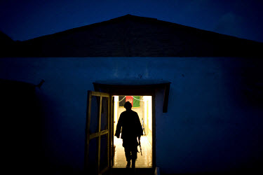 An Afghan National Army (ANA) soldier from Turkan Company, 2nd Brigade stands at the entrance to his barracks at Forward Operating Base (FOB) Blessing in the Pech Valley.