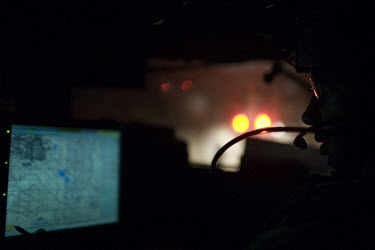 A US Army soldier from F Company, 201st Brigade Support Battalion monitors the tracking and GPS system in his humvee during a convoy to Forward Operating Bases along the Pech Valley. The unit often ge...