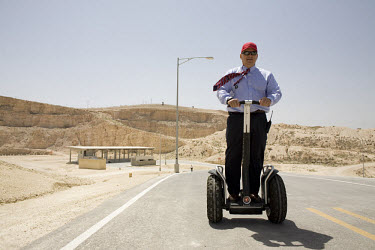 US Army Major General (retired) Gary Harrell, Director of the King Abdullah II Special Operations Training Center (KASOTC), on a Segway with a shooting-range in the background. Jordan and the United S...