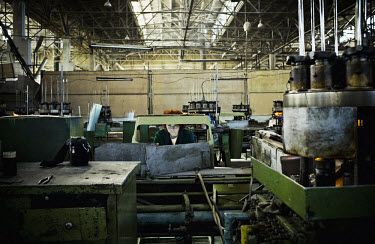 A woman works at the Mailuu Suu factory. During Soviet times, most of the electric lightbulbs of the USSR were made here. Today, only one third of the factory is still working and many workers haven't...
