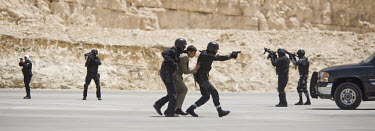 Jordanian special forces simulate a hostage release operation during the opening of the King Abdullah II Special Operations Training Center (KASOTC) near Amman. Jordan and the United States have commi...