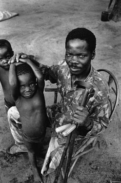 A wounded and retired RENAMO (Mozambican National Resistance) soldier reunited with his children after the 17-year long civil war came to an end.