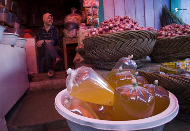 Palm oil to be used for cooking, for sale in a market in Rengat.