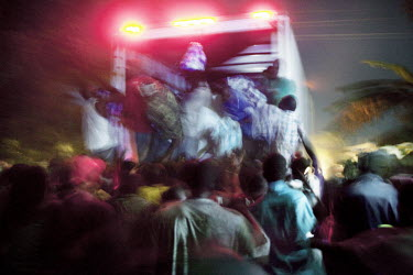 A truck transporting food aid is scaled before reaching its destination by desperate people in Leogane, near the epicentre of the earthquake that struck sixteen days earlier. The truck did not have a...