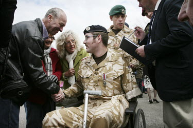 Soldiers from the British army's 11th EOD regiment (Counter IED Task Force) are greeted by their families and members of the public in Didcot, Oxfordshire, on their return from Afghanistan. Sapper Rya...