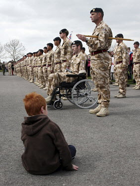 Soldiers from the British army's 11th EOD regiment (Counter IED Task Force) on parade in Didcot, Oxfordshire, on their return from Afghanistan. Sapper Ryan Seary, 21, who lost an arm and a leg when a...