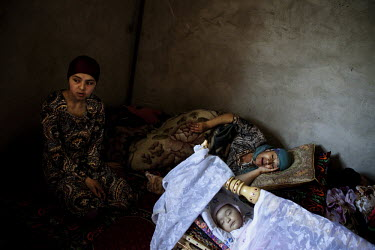 Ethnic Uzbek women and children who fled their homes in Kyrgyzstan and are now staying in a house close to the Uzbekistan border to protect themselves and in the hope of crossing.Fighting between ethn...