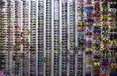 Sunglasses for sale displayed in the Yiwu Small Commodity Market. The city of Yiwu comprises of numerous export markets selling more than 17 million different products to more than 200 countries world...