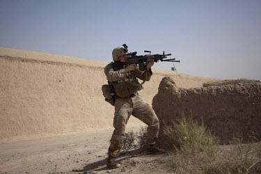 A US marine from 3-6, Lima Company, 2nd Platoon returns fire in a two hour firefight against the Taliban who attacked the platoon close to their base in northern Marja.