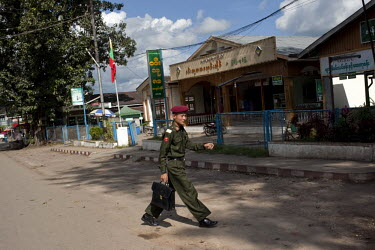 A young Burmese Army officer crosses a road in Pyin U Lwin.