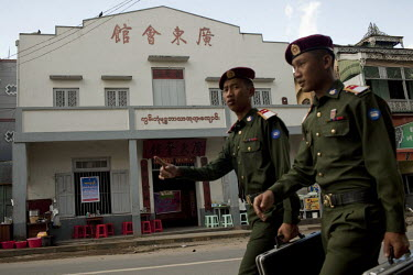 Burmese Army officers walk past a Chinese restaurant in Pyin U Lwin.