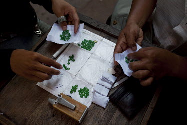 Jade traders show their wares at the Jade Market in Mandalay. Much of the Burmese junta's wealth comes from the trade in precious stones.