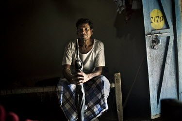 Varse Malla from the Dorna tribe poses for a portrait inside his small empty hut in Dornapal, a Salwa Judum village. Salwa Judum (meaning Peace March) is an anti-Naxalite movement in the state of Chha...