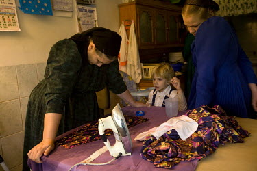 Catherine Rempel and her children make clothes at their home in a Mennonite village. Near the city of Santa Cruz, there are about 15,000 Mennonites living in isolated communities. Mennonites are a gro...