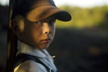 A portrait of a boy in a Mennonite village. Near the city of Santa Cruz, there are about 15,000 Mennonites living in isolated communities. Mennonites are a group of Christian Anabaptists, part of the...