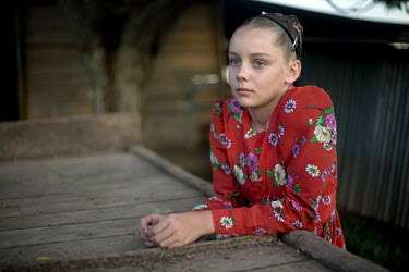 A portrait of a girl in a traditional dress in a Mennonite village. Near the city of Santa Cruz, there are about 15,000 Mennonites living in isolated communities. Mennonites are a group of Christian A...