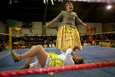 26 year old wrestler Juanita la Carinosa (fighting name), Mery Llanos Saenz (real name) stands on the neck of 17 year old Alicia Flores (fighting name), Patricia Kaly (real name) during a fight at the...