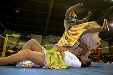 26 year old wrestler Juanita la Carinosa (fighting name), Mery Llanos Saenz (real name) jumps on 17 year old Alicia Flores (fighting name), Patricia Kaly (real name) during a fight at the Multifuncion...