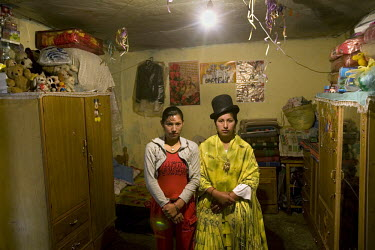 17 year old wrestler Alicia Flores (fighting name), Patricia Kaly (real name), right, stands in her room next to her sister Marisol Kaly. Patricia is a Cholita, a wrestler of native Aymara descent. Wh...