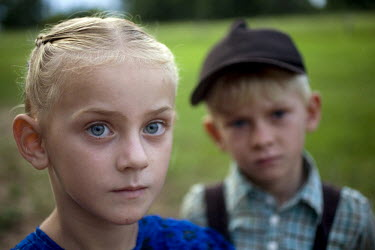 A portrait of a boy and girl in a Mennonite village. Near the city of Santa Cruz, there are about 15,000 Mennonites living in isolated communities. Mennonites are a group of Christian Anabaptists, par...