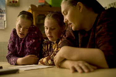 Catherine Rempel sings religious songs wither her daughters at their home in a Mennonite village. Near the city of Santa Cruz, there are about 15,000 Mennonites living in isolated communities. Mennoni...