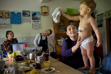 The youngest member of the Rempel family sits by the dinner table at his family's home in a Mennonite village. Near the city of Santa Cruz, there are about 15,000 Mennonites living in isolated communi...