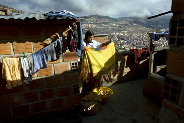 26 year old wrestler Yolanda La Amorosa (fighting name), Veraluz Cortez (real name) washes clothes on her rooftop. Veraluz is a Cholita, a wrestler of native Aymara descent. When Cholitas fight they w...