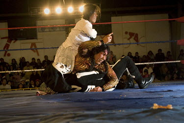 29 year old wrestler Martha La Altena (fighting name), Yenny Wilma Maraz (real name), centre, fights Picudo and Gran Mortis with her partner Gotita de Amor (fighting name), Lidia Quispe Amaru (real na...