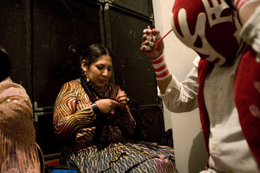 29 year old wrestler Martha La Altena (fighting name), Yenny Wilma Maraz (real name) sits in the changing room with other wrestlers at the Multifuncional building. Yenny is a Cholita, a wrestler of na...