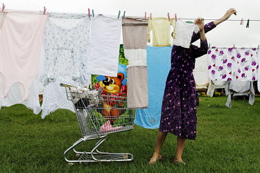 A teenage girl hangs laundry to dry in a Mennonite village. Near the city of Santa Cruz, there are about 15,000 Mennonites living in isolated communities. Mennonites are a group of Christian Anabaptis...
